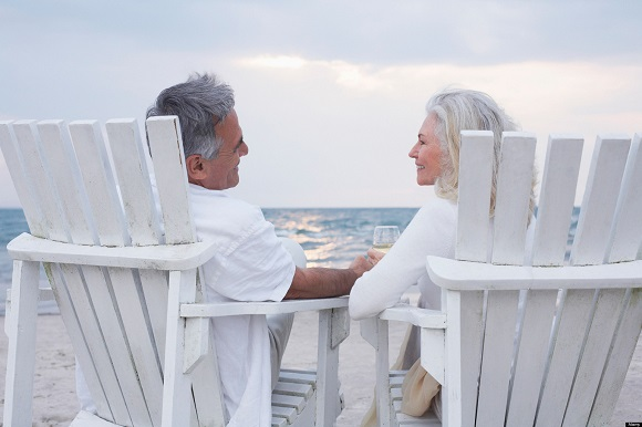 Couple Sitting in Chairs on Beach